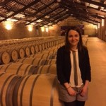 Marta Echavarri of CVNE winery showing off the barrel room, designed by Gustave Eiffel, who also designed the Eiffel Tower in Paris.
