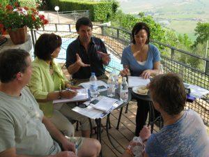 Travel Writing Class on veranda of hotel overlooking Tuscan landscape.